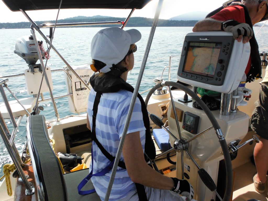 Member Susy Webb at the Helm