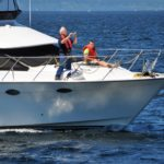 Skipper Sandy Thomas at the helm while husband and grandson enjoy the ride
