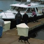 Skipper Sally Calkins manages her lines as others help