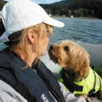 Max Madsen Checking out the new passenger on his dinghy