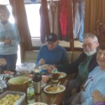 """Everyone gathered on """"Pound Foolish"""" our first night in Port Ludlow"""