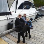 """Sanfy & Patti sitting on the dock with their """"boys"""""""