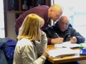 Instructor R Blackburn-Lappin works with students Suzy W and Duane B