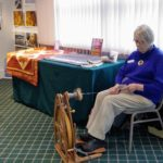 Ruth demonstrates how to spin Jacob  Sheep's wool