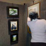Andrea viewing Bob Stem's paintings
