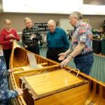 Gordon answering questions regarding his personally built canoe