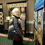 Catherine B showing her fabric art designs