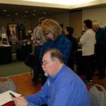 Ray Madsen discusses genealogy with Karen M