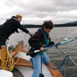 Paula looks on as Audrey tries to snag another mooring ball