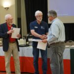 Gary Hicks being presented Certificates of successful completion of Marine COmmunications and