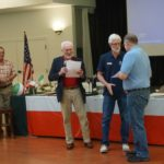 Education Officer Duane Webb  presenting Ray Masen certificate of completion of Marine COmmunications