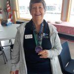 Sandy shows us her hard earned medal completing the 5k