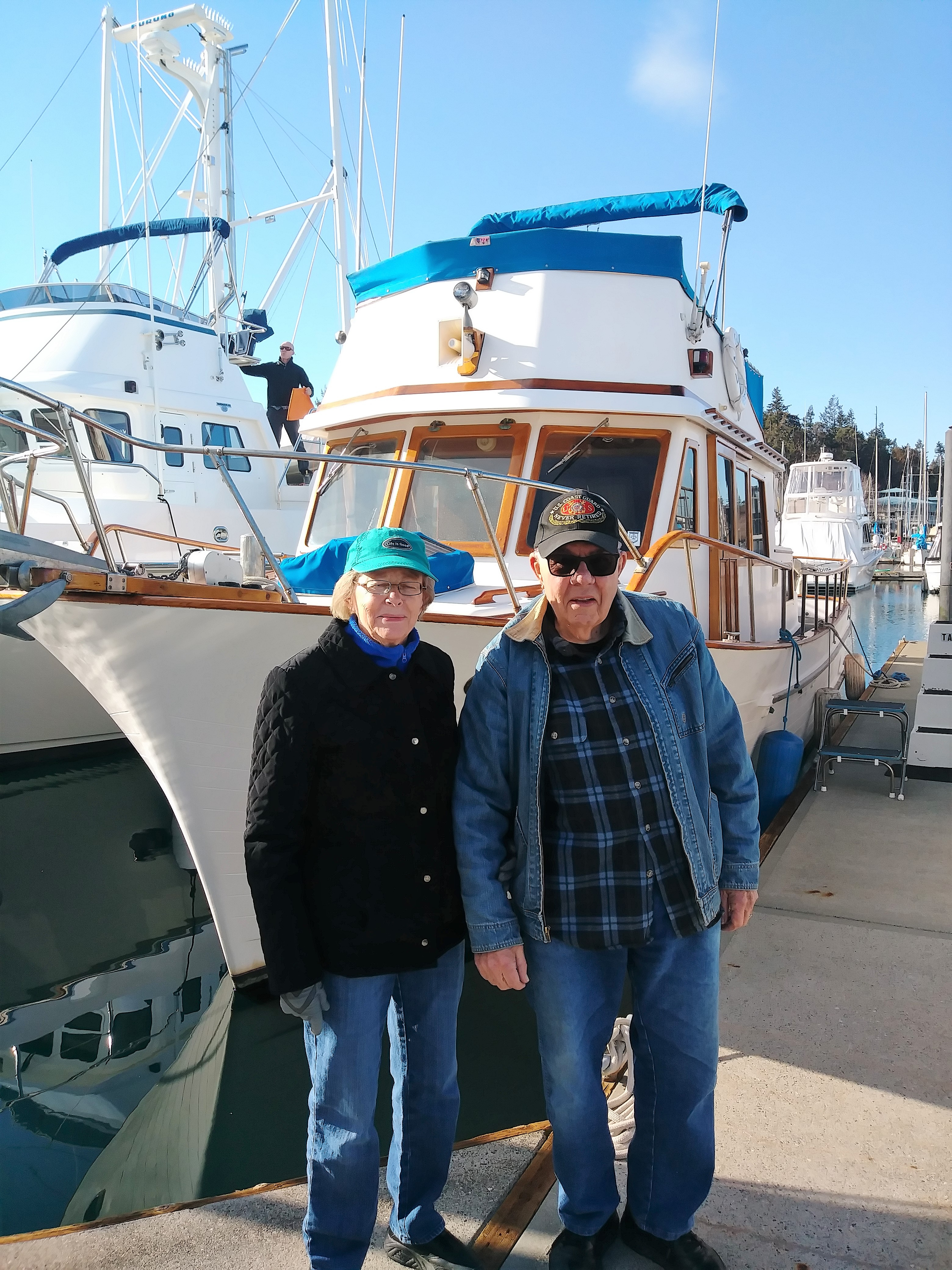 "Grace & Dick Schoel by their new boat ""Eagles Nest"""