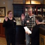 Membership Chair Sandy Thomas swearing in new members The Barnabys